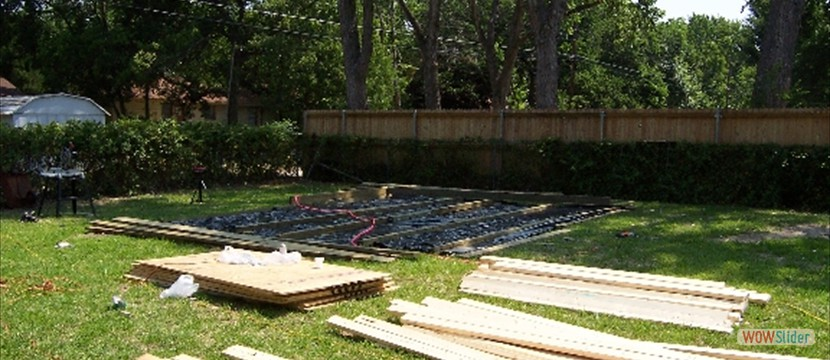 Vapor barrier laid out, and lumber staged